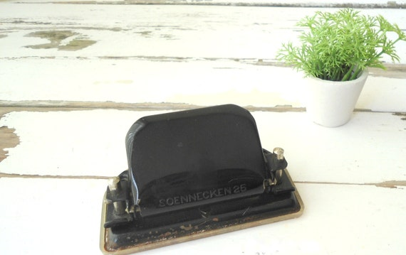 vintage black office hole puncher branded Soennecker 25 dating from the 40's