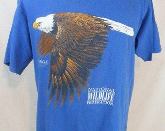 Vintage 1990 National Wildlife Federation Bald Eagle Blue Tshirt Size XL.