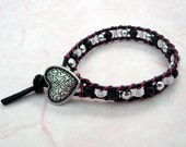Black leather wrap bracelet with silver heart button
