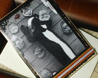 Caught- halloween skunk handmade blank card with vintage halloween imagery