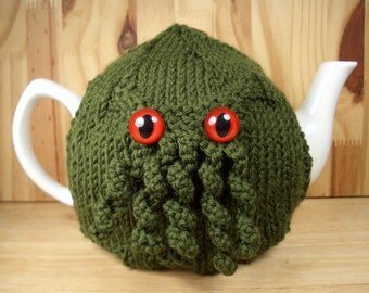 Green Curly Cthulhu Tea Cosy - a warm and washable sweater for your teapot - you choose eye color