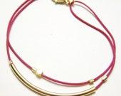 Minimalist gold tube stacking bracelet in dark fuchsia