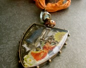 Vintage religious images resin collage assemblage pendant