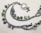 Charming Silver Pendant Necklace with Mixed Gems & Braided Leather