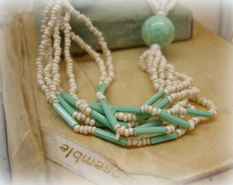 very vintage multi strand czech glass necklace . teeny ivory pearl glass seed beads . peking glass and faceted aqua tubes