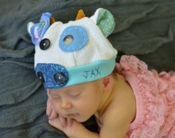 Infant Cow Jax Hat in white and blue - great for photography prop