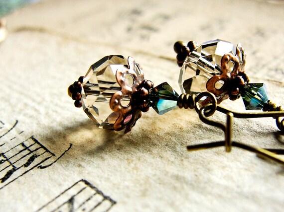 S E C L U D E D... Taupe and teal crystals on brass earrings