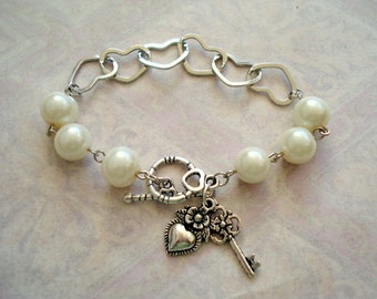 Open Hearts and White Glass Pearl with Charms, Bracelet