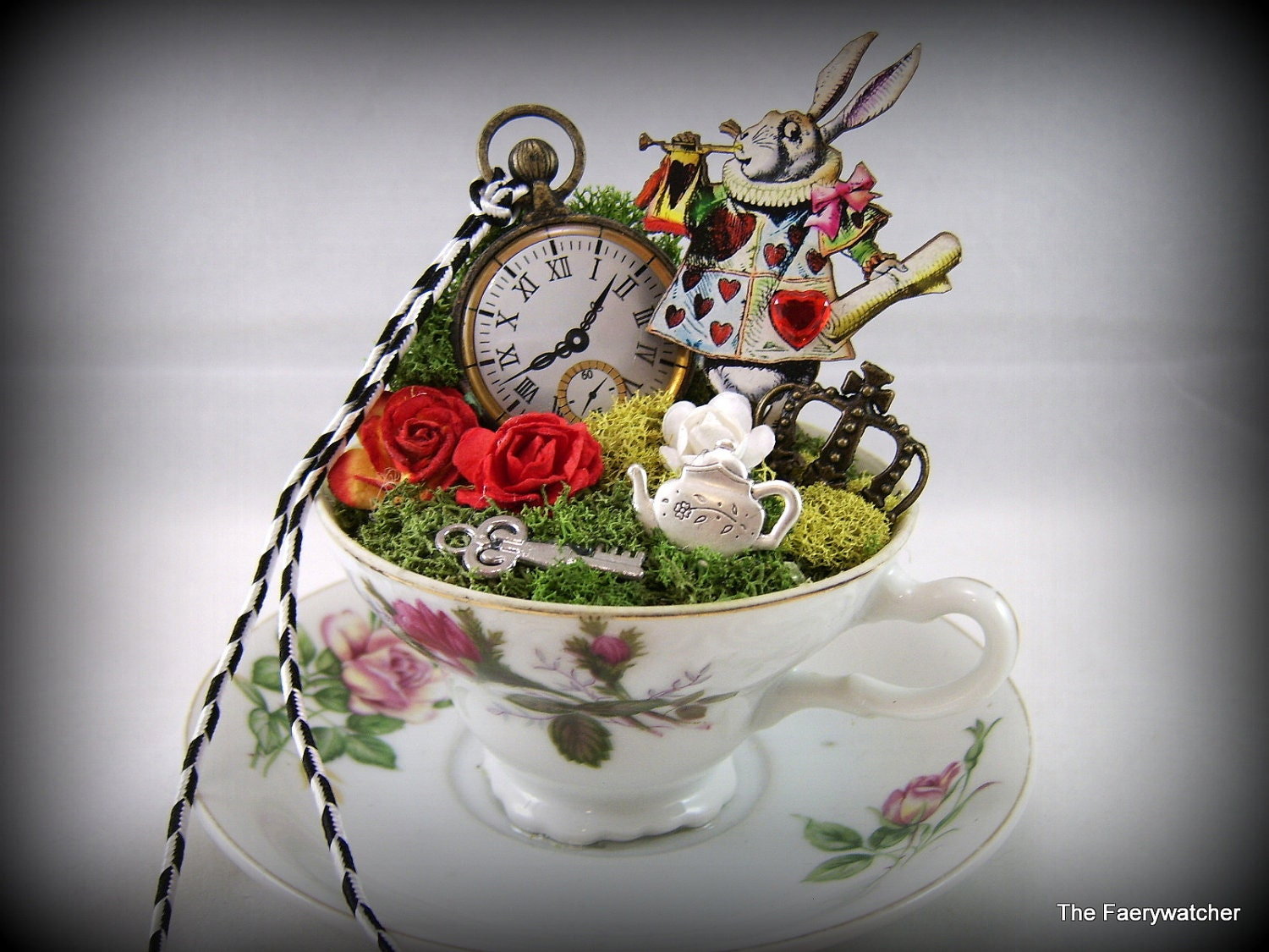 Alice in wonderlands white rabbit story cup centerpiece cake