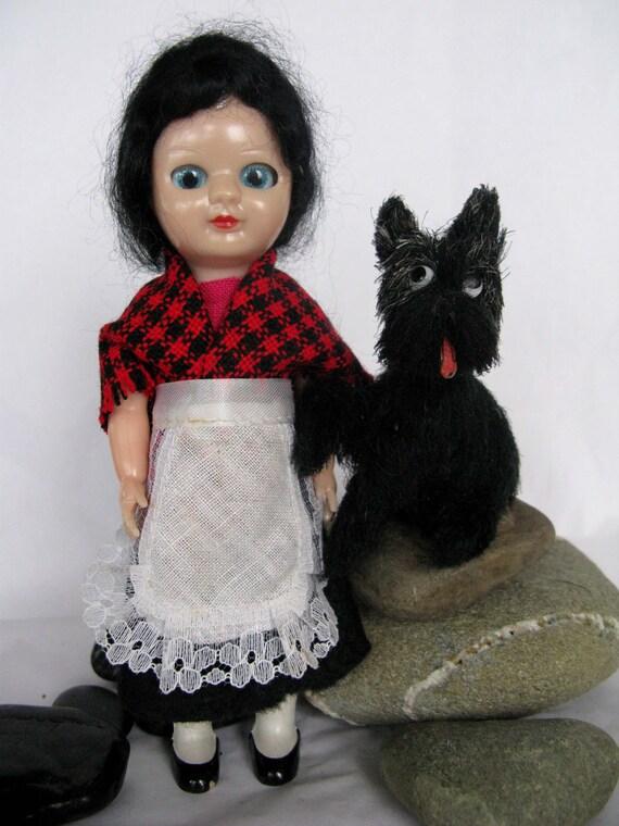 creepy doll with her creepy dog