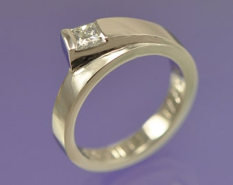 A 4mm princess diamond engagement ring (0.40ct) set in 18k white gold.