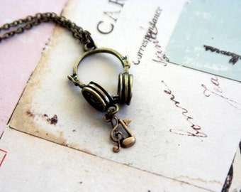 headphones. music notes. necklace in antiqued brass