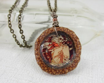 One of a kind collage necklace with real acorn and winter art scene by Alphonse Mucha