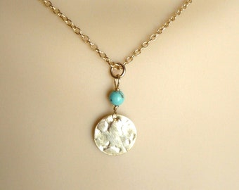 Gold disk and turquoise necklace