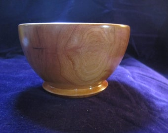 Handmade beautiful cherry wood bowl made from wood from construction site