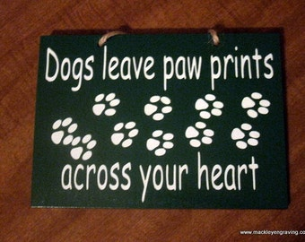 Dogs leave paw prints across your heart wooden painted sign
