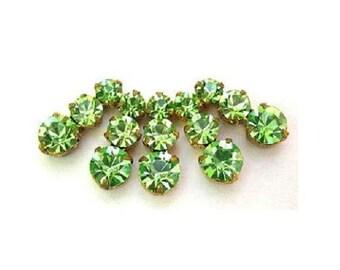 5 Vintage Swarovski jewelry findings 3 rhinestone crystals in brass setting, light green