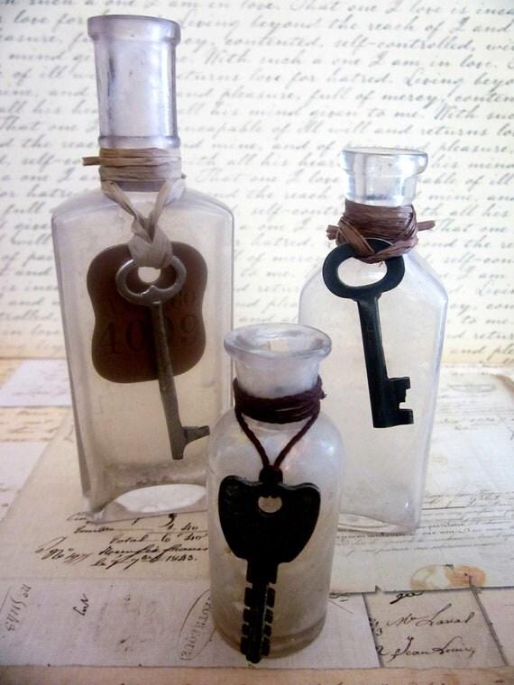 Three Antique Medicine Bottles With Skeleton Keys