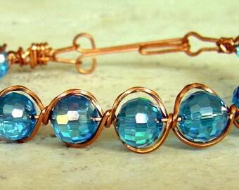 Wire wrapped blue czech glass bracelet