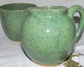 Bright green and spotty pitcher and bowl set