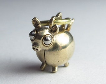 Pig necklace PIGGLEBOT solid brass with stainless steel eyes