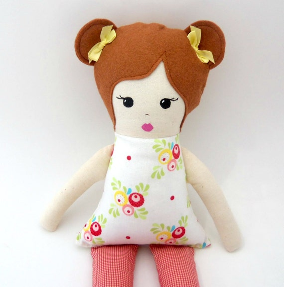 cloth rag doll with light brown hair and pig tails