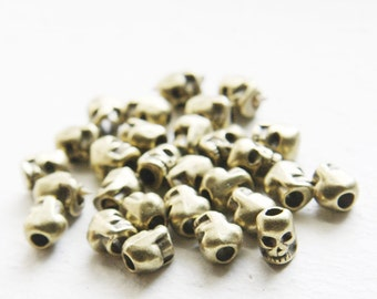 30pcs Antique Brass Tone Base Metal Spacers-Skull 7x7.5mm with hole size 2.5mm (13906Y-J-77)