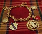 Gold Tone Charm Bracelet 7 Charms Fluer de Lis Crown Coat of Arms