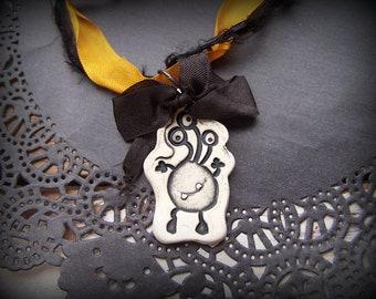Halloween Three Eyed Creature Clay Ribbon Necklace