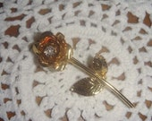 Rose brooch vintage gold toned rose brooch with faux diamond in center