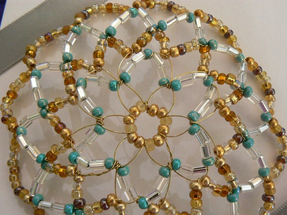 beaded kippah in shades of turquoise gold a d clear
