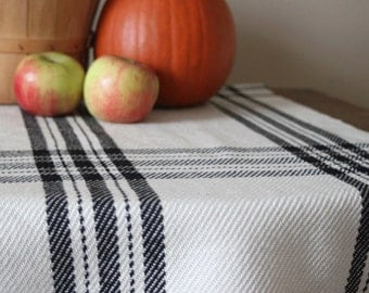 Handwoven plaid table runner in ivory and black farmhouse plaid. Handmade by Kate Kilgus.