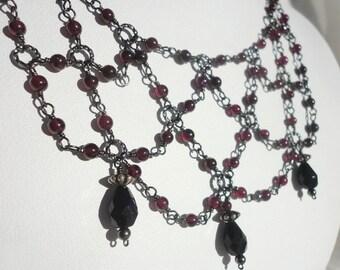 Gothic Garnet and Gunmetal Necklace: Garnet Beads on Gunmetal Wire in Draped Chain Pattern