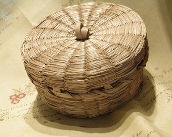 A Vintage Woven Grass Round Covered Basket