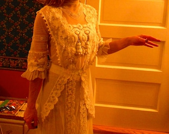 """1912-14, 34"""" bust, white cotton net, """"tea gown"""" with thick hand made lace medalins inserts"""