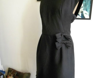"1960's, 34"" bust small xsmall, silk and wool, black sheath dress, with heavily beaded fringed hem"