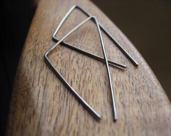 triangle earrings in niobium. hammered silver hoops.