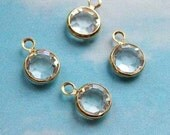 10 tiny white (clear) swarovski crystal charms, gold plated setting, 7mm