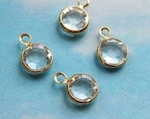 100 tiny white (clear) swarovski crystal charms, gold plated setting, 7mm