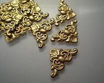 12 tiny brass corner brackets, No. 1