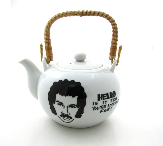 Lionel Richie Teapot Hello Is It Tea With rattan handle