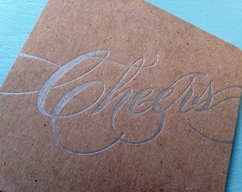 Cheers Coasters Letterpress Silver  - 6 on Recycled Chipboard