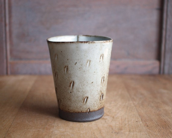 dark stoneware clay cup