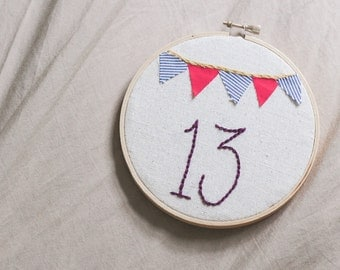 custom table numbers, embroidered wedding decor