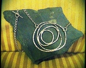 Hammered silver swirl necklace
