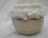 Felted vessel with raw wool locks and handspun embellishment