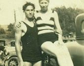Macho Man Swim Suit Bathing Suit Man Woman Sitting on Car At The Lake Antique Vintage Black and White Photo Photograph