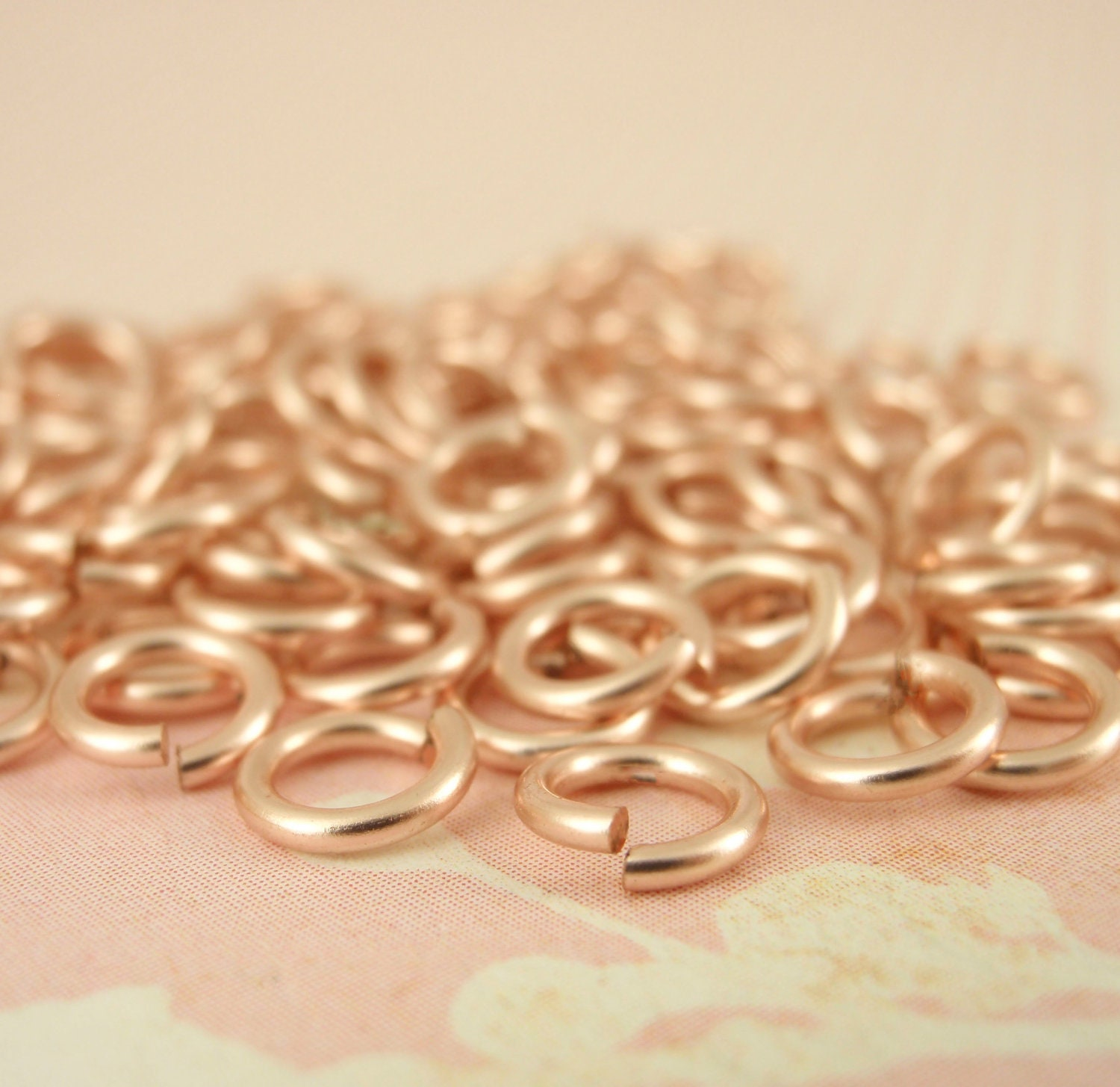 100 Jump Rings in Rose Gold Colored Enameled Copper in 24 22