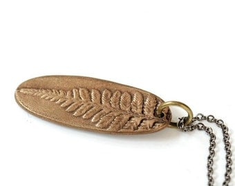 Oval bronze fern pendant with antiqued brass chain