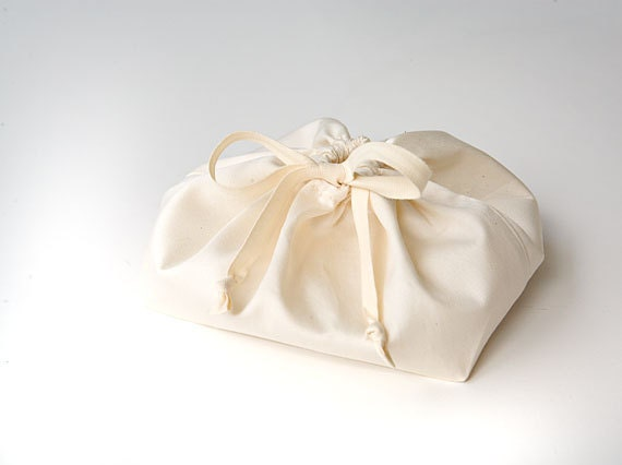 Nursing pads in natural bag. Breast pads in organic fabric. Ultra-absorbant cloth pads in a gift bag. New Mommy Gift.